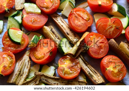 Vegetables roasted with rosemary,garlic and olive oil. Includes tomatoes , white aubergine  and zucchini.Healthy eating.  - stock photo