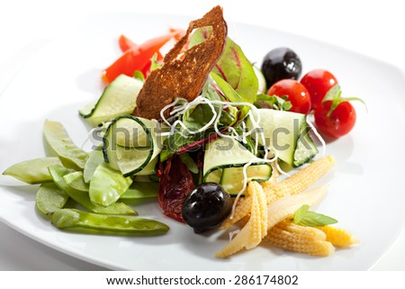 Vegetables Salad with Corn, Tomato, Green Peas and Cucumber - stock photo