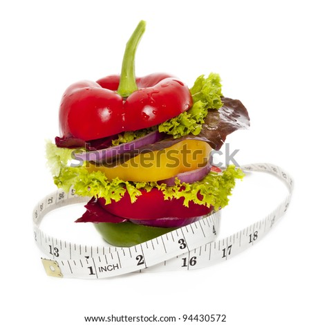 Vegetables sandwich with tape measure around it. Isolated on White - stock photo