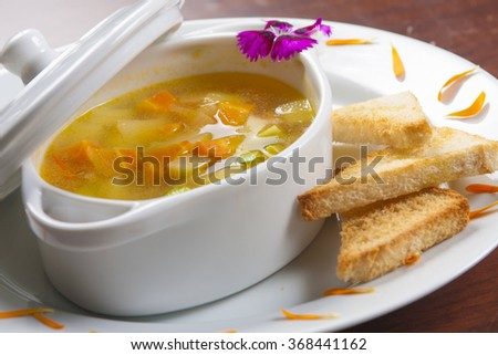 Vegetables soup with toasts