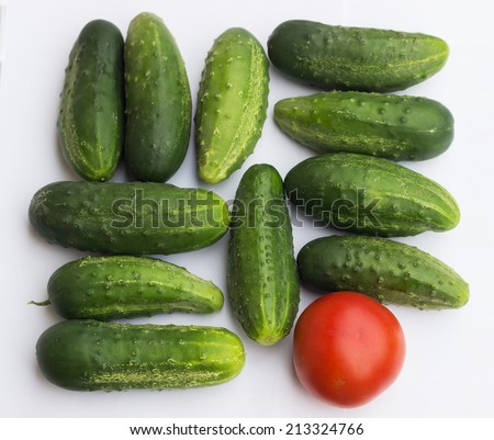 vegetables. Tomato and cucumbers. Be different!  How to stand out - marketing & advertising!  Business concept - branding, different, original.  - stock photo