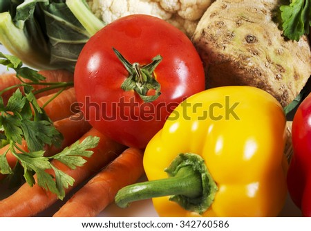 Vegetables - tomato, carrot, paprika, cauliflower, celery and parsley - stock photo