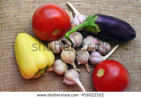 Vegetables, tomato, eggplant, pepper, paprika, garlic on sacking Ukraine