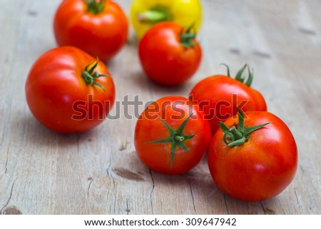 Vegetables tomatoes and pepper on wooden background