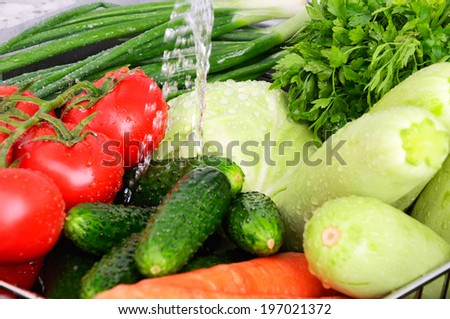 vegetables under running water and drops horizontal closeup  - stock photo