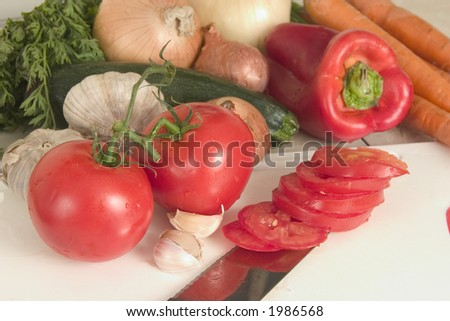 Vegetables with sliced tomatoes - stock photo