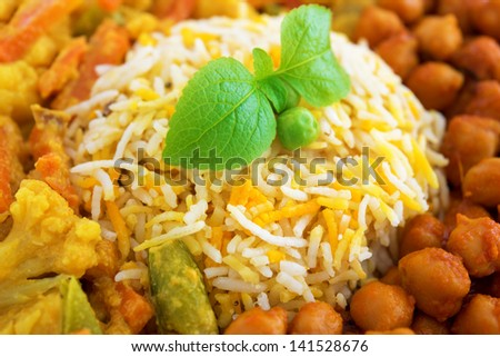 Vegetarian biryani rice or briyani rice close-up, fresh cooked with steam, delicious indian food. - stock photo