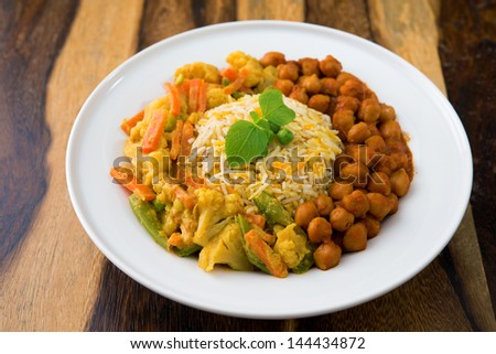 Vegetarian biryani rice or pilau rice with curry, fresh cooked basmati rice with spices, delicious Indian food. - stock photo