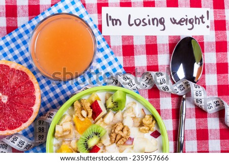 Vegetarian Breakfast: fruit salad with yogurt, grapefruit juice and fresh grapefruit on the table. The concept of weight loss and healthy eating. Healthy low-fat diet. - stock photo
