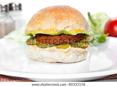Vegetarian burger made from integral bred with  tofu cream, mustard,  sour cucumber and  lettuce - stock photo