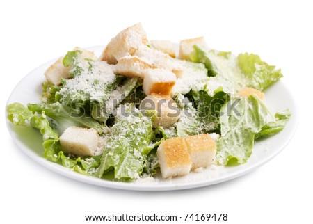 vegetarian caesar salad on white plate isolated on white background - stock photo