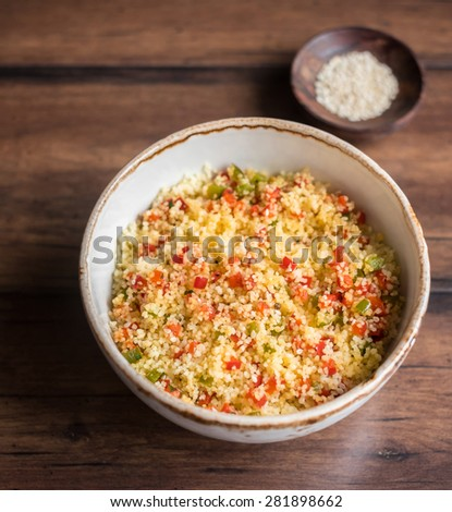 Vegetarian couscous salad made with bell pepper in a bowl, selective focus - stock photo
