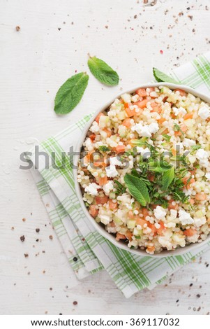 Vegetarian couscous salad made with tomato, cucumber and fresh mint