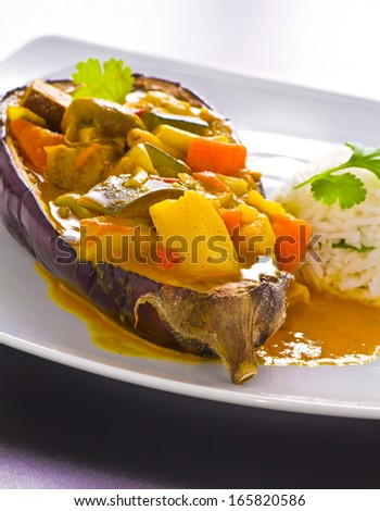 Vegetarian Curry served in eggplant with ball of steamed rice - stock photo