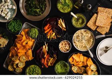 vegetarian dinner party snacks cheese nachos stock photo royalty