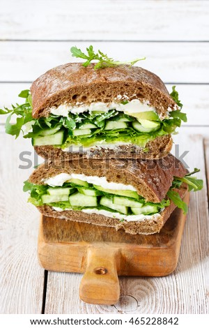 Vegetarian fitness sandwich with cottage cheese, cucumber and lettuce.