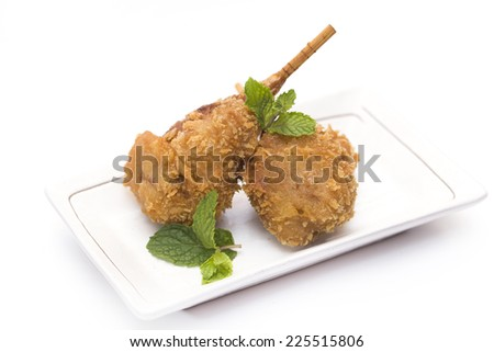Vegetarian food, Breaded deep fried mushrooms garnished with mint served with stream brown rice - stock photo