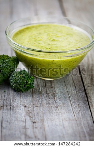 Vegetarian food. Broccoli soup with garnish - stock photo