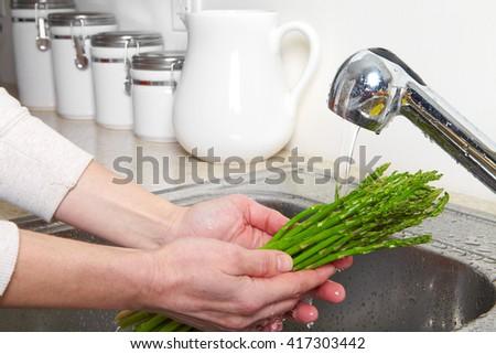 Vegetarian food in the sink. Fresh asparagus - stock photo