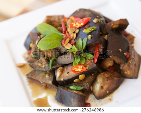 Vegetarian food Thai Style Eggplant Stir-Fry with Bean paste and chillli, Thai basil  - stock photo