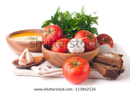 Vegetarian food, vegetables, herbs and bread closeup isolated - stock photo