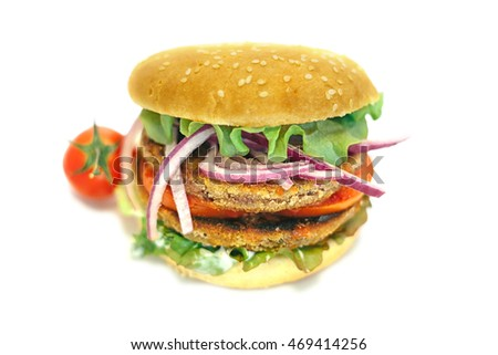 vegetarian hamburger with lettuce, tomato, onion and bun in white background