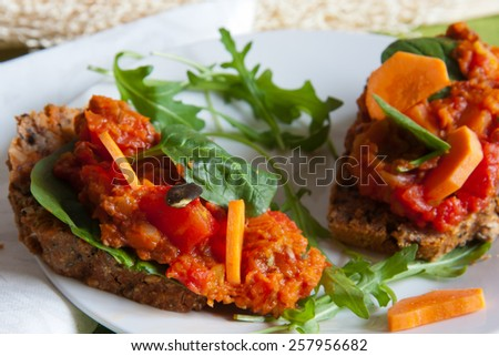 Vegetarian healthy sandwich served on a white plate garnished with arugula salad - stock photo