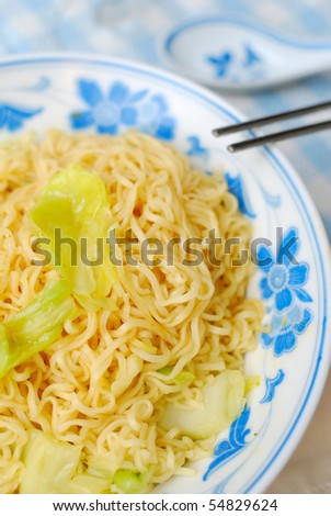 Vegetarian instant noodles with healthy vegetables. Suitable for concepts such as diet and slimming, healthy lifestyle, and food and beverage. - stock photo