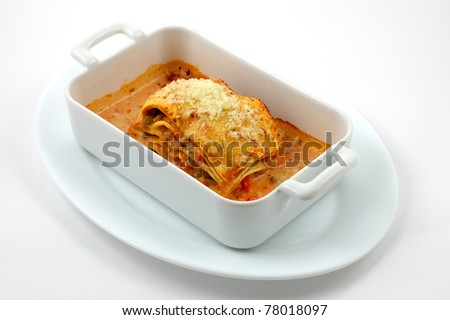 Vegetarian lasagne with ricotta cheese and spinach filling - stock photo
