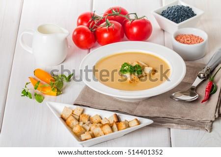 Vegetarian lentil cream soup with croutons, lentil and vegetables on ...