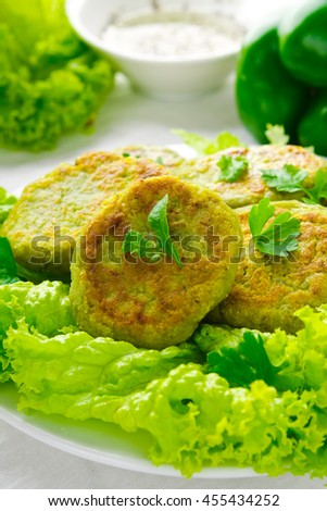 Vegetarian patties of broccoli with salad, pepper, greens and herbs, on white background - stock photo