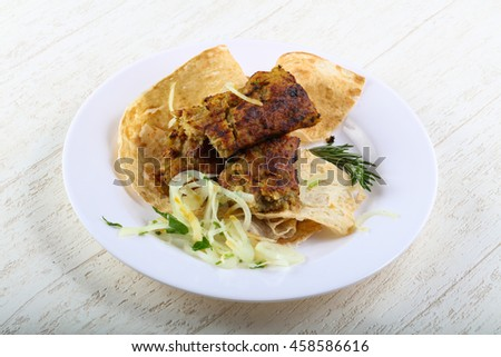 Vegetarian potato kebab with onion, parsley and bread