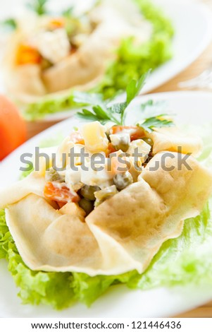 Vegetarian salad with boiled vegetables wrapped in a pancake. Healthy food - stock photo