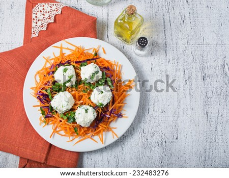 Vegetarian salad with carrot, red cabbage, parsley and cheese ball. Space for text - stock photo
