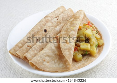 Vegetarian sandwich, chapati with cooked vegetables. - stock photo