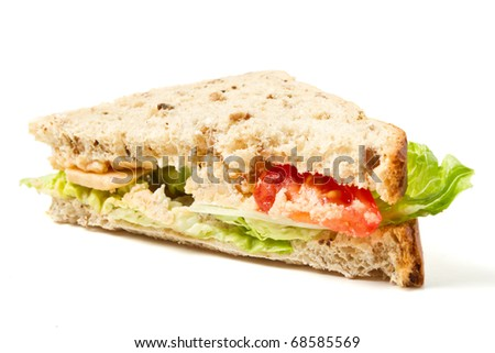 Vegetarian Sandwich of cheese, tomato and lettuce on brown Granary bread. - stock photo
