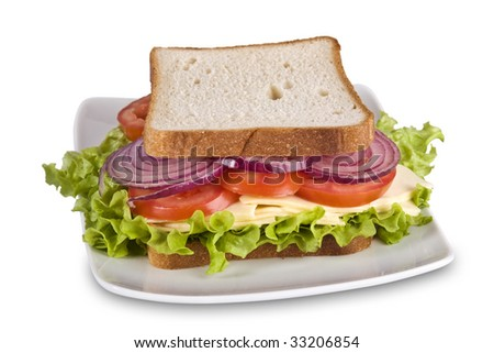 Vegetarian sandwich with cheese, lettuce, tomato and onion in white bread isolated on white. It has a clopping path. - stock photo