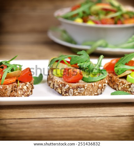 Vegetarian sandwiches and fresh salad in bowl  - stock photo