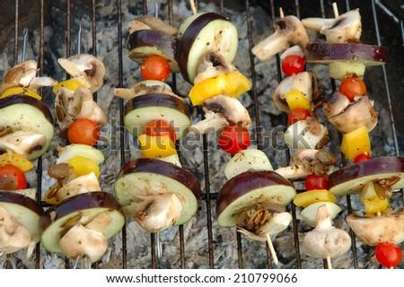 vegetarian shish-kebab cooking on barbecue - stock photo