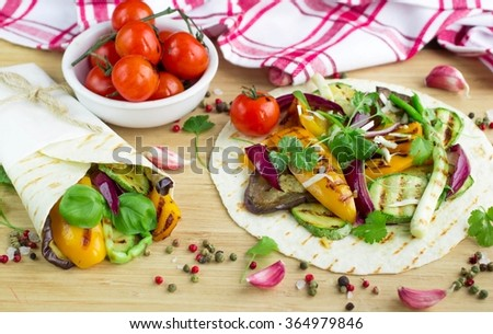 Vegetarian snack tacos with grilled vegetables - stock photo