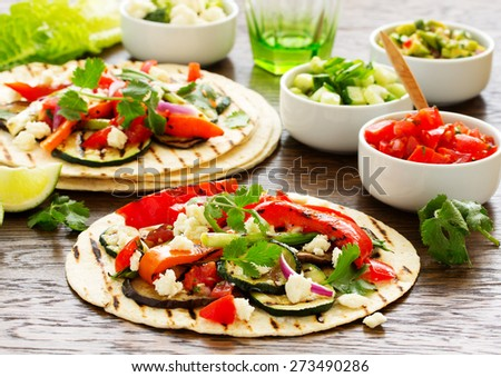 Vegetarian snack tacos with grilled vegetables and salsa. - stock photo