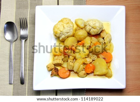 Vegetarian stew with dumplings and fake chicken pieces, carrots, potato and other mixed vegetables - stock photo