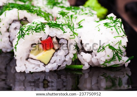 vegetarian sushi set roll on wooden background - stock photo