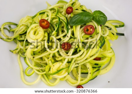 vegetarian zucchini noodles with cherry tomatoes and pepper - stock photo