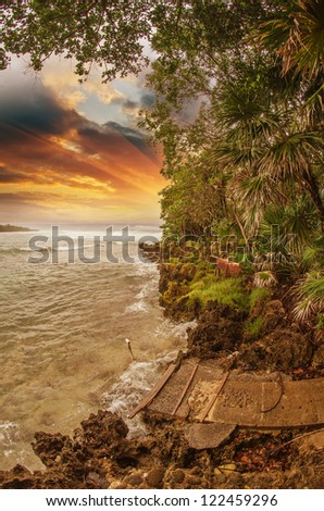 Vegetation and Rocks with Sea and Stormy Sky, Honduras - stock photo