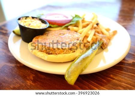 veggie burger and fries at restaurant - stock photo