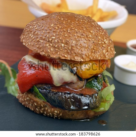 veggie burger with vegetables, fries sauce - stock photo