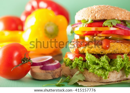 veggie chickpea and sweetcorn burger with pepper jalapeno onion - stock photo