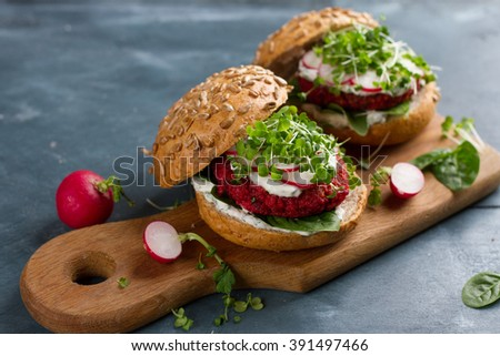 Veggie couscous beet burgers with radish and seedlings, selective focus - stock photo
