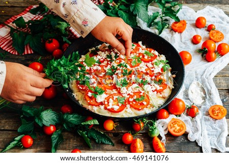 Veggie pizza. Pizza with tomatoes, shallot and fresh herbs. Cherry ...